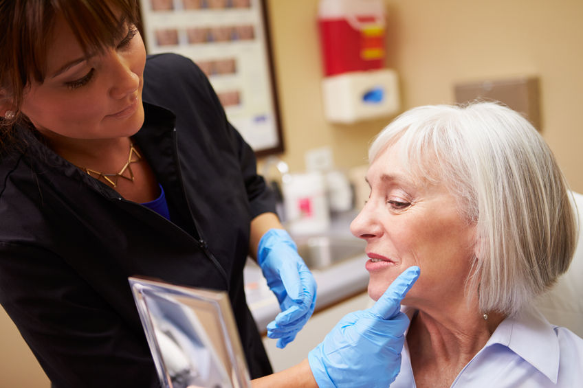 Elderly woman receiving skin rejuvenation treatment in Houston, TX